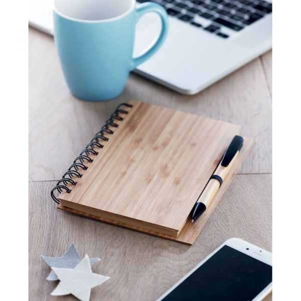 bamboo notebook with other stationary objects on a desk
