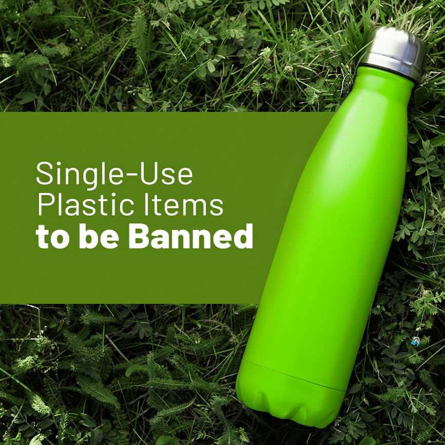 green bottle on grass with single-use plastic items written